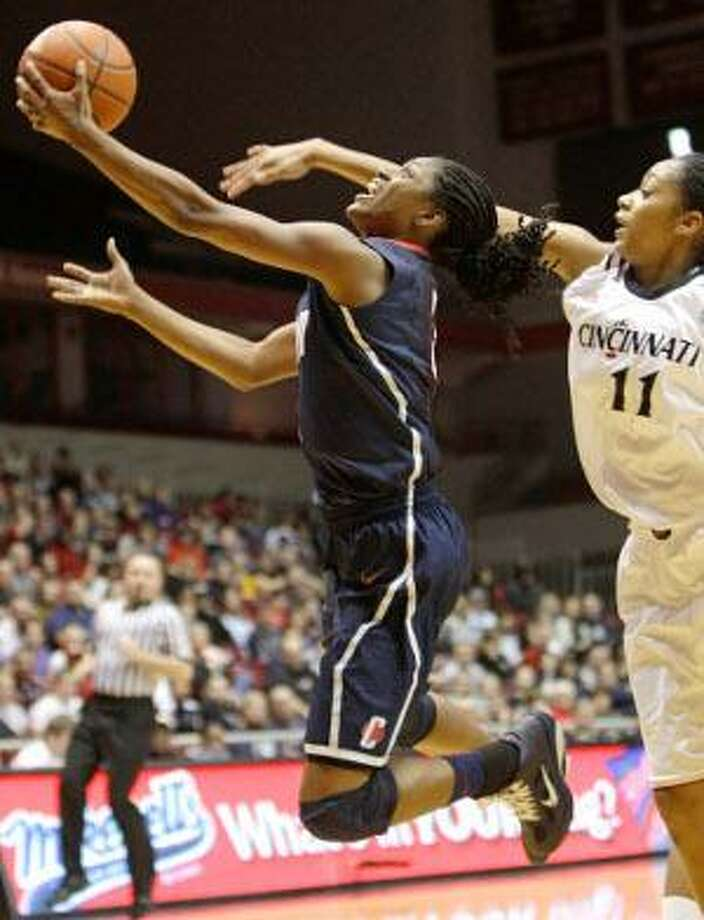 AP Connecticut guard Tiffany Hayes, left, drives to the basket past Cincinnati guard Tiffany Turner (11) during the first half of Saturday's game in Cincinnati. The Huskies host No. 3 Duke Monday at Gampel Pavilion at 7 p.m.