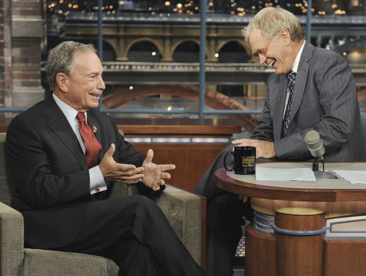 In this photo released by CBS, New York City Mayor Michael Bloomberg, left, shares a laugh with host David Letterman on the set of the