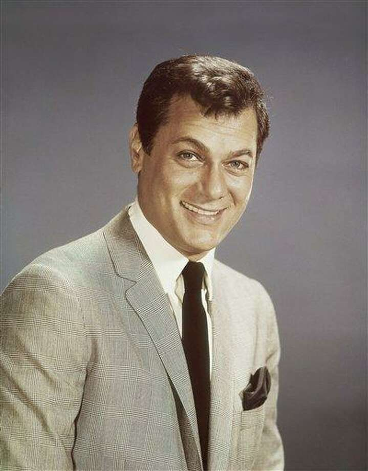 Actor Tony Curtis is shown in this 1965 file photo. Curtis, whose real name was Bernard Schwartz, was perhaps most known for his comedic turn in Billy Wilder's 'Some Like It Hot' with co-stars Marilyn Monroe and Jack Lemmon has died at 85 according to the Clark County, Nev. coroner. (AP Photo, File) Photo: ASSOCIATED PRESS / AP
