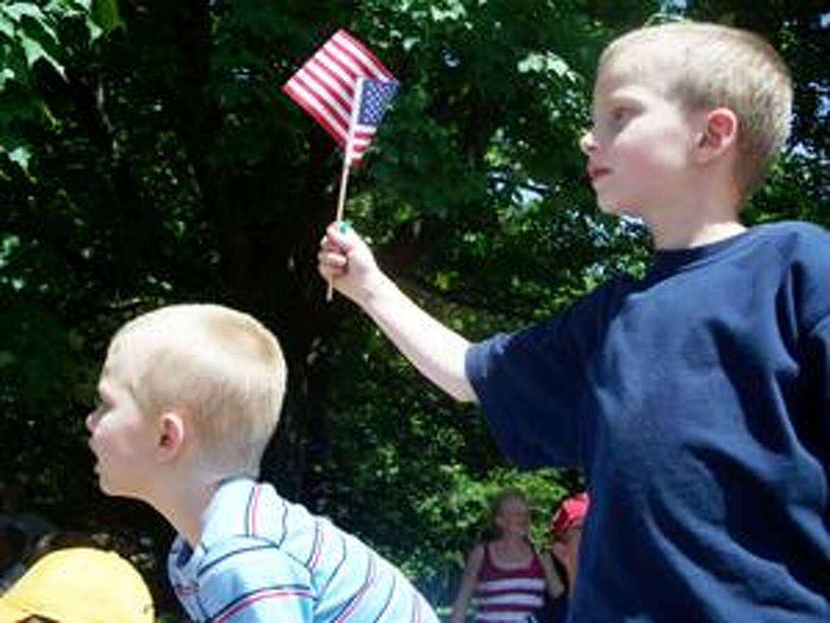 Special to The Press) Evan Johnson, 5, of Portland, was there with his parents, Bryan and Mary, and his brothers Andrew, 5, and Nicholas, 1, to enjoy the parade.