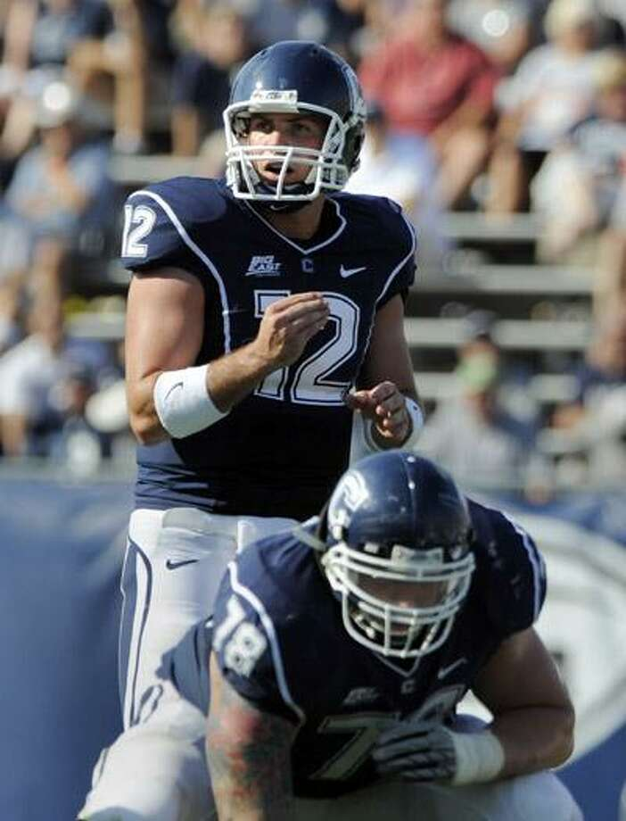 Connecticut quarterback Cody Endres (12) looks over Buffalo's defense during the second half of Connecticut's 45-21 victory in their NCAA football game in East Hartford Saturday, Sept. 25. (AP) Photo: ASSOCIATED PRESS / FR153656 AP
