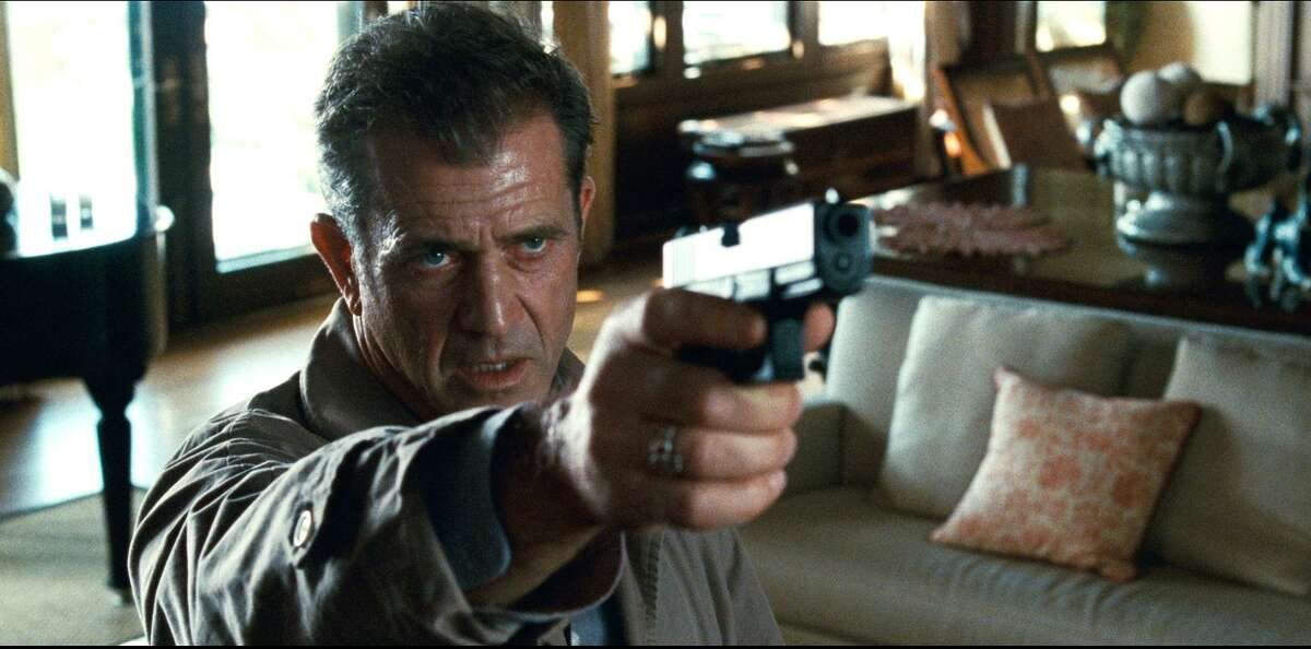 In this film publicity image released by Warner Bros., Mel Gibson is shown in a scene from,