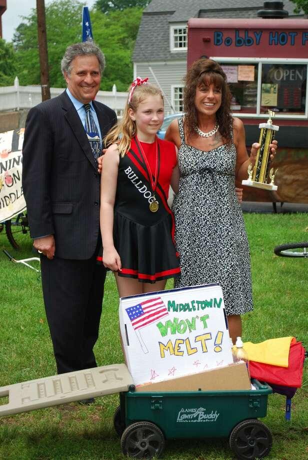 Mayor Sebastian Giuliano, Emily Wilson and Mary Monarca. The Lawrence School Bulldog Cheerleaders were given  the Veterans Award.