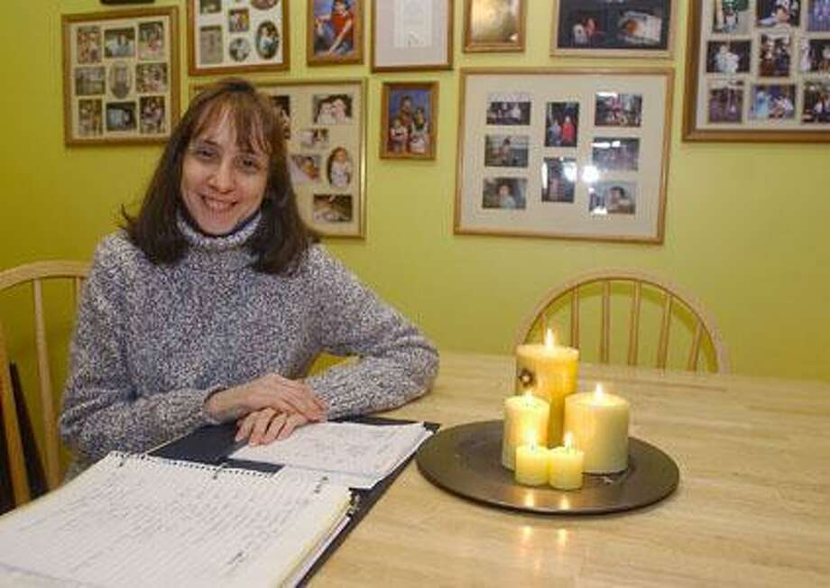 Middletown resident Ruthanne (Rae) Johnson, seen looking over current city budget documents in her home in February 2009, is running as a Green Party candidate for the state Senate.  (Middletown Press file photo)