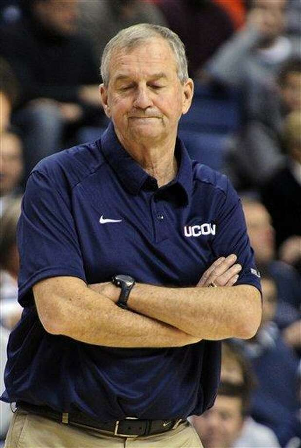 Connecticut head coach Jim Calhoun reacts during the second half of his team's 79-78 double overtime loss to Louisville in an NCAA college basketball game in Hartford, Conn., on Saturday, Jan. 29, 2011.  (AP Photo/Fred Beckham) Photo: AP / FR153656 AP