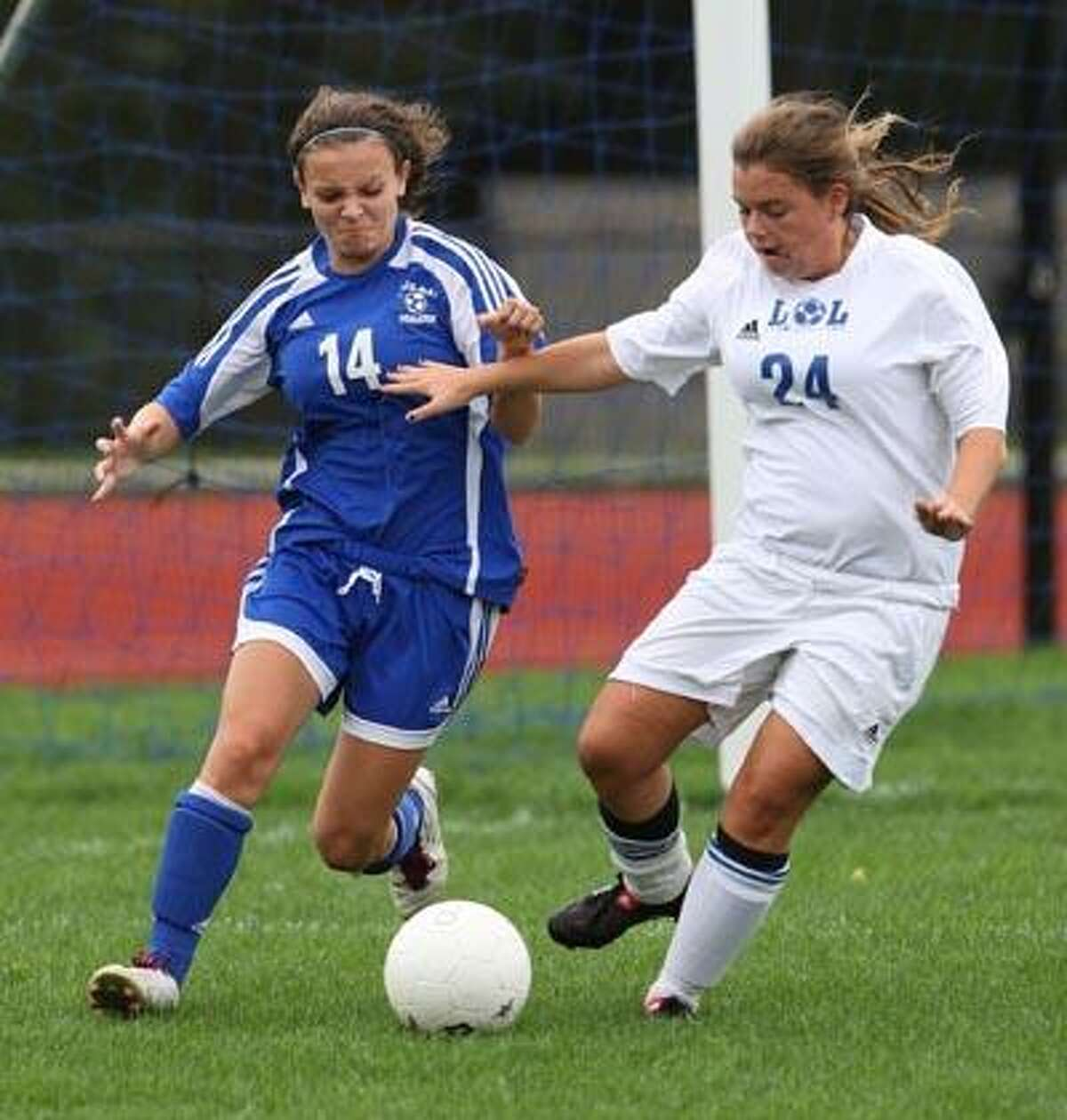 Hale Ray defender Beth Schoell takes on Old Lyme's Liv Wilkie Wednesday. (Todd Kalif