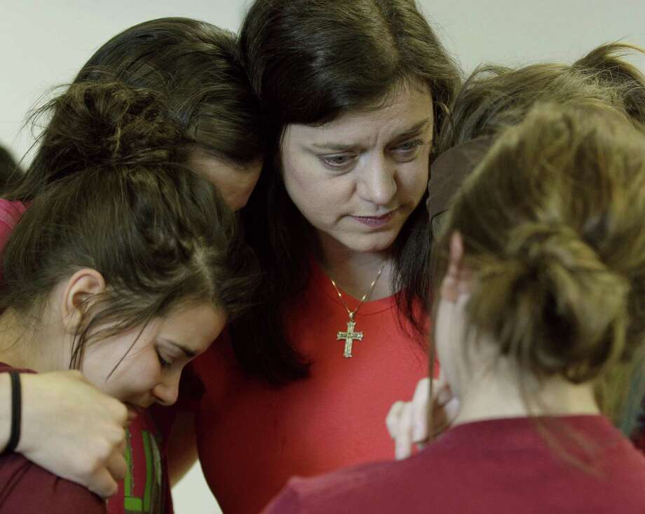 Tracey Presslor, center, the aunt of Will Norton, hugs unidentified friends of his after a news conference with family members at Freeman Hospital in Joplin, Mo. on Saturday, May 28, 2011. Norton's body was found Friday in a pond after he was pulled out of his vehicle on his way home from his high school graduation Sunday by an EF-5 tornado that tore through much of the city killing at least 139 people. (AP Photo/Charlie Riedel) Photo: AP / AP