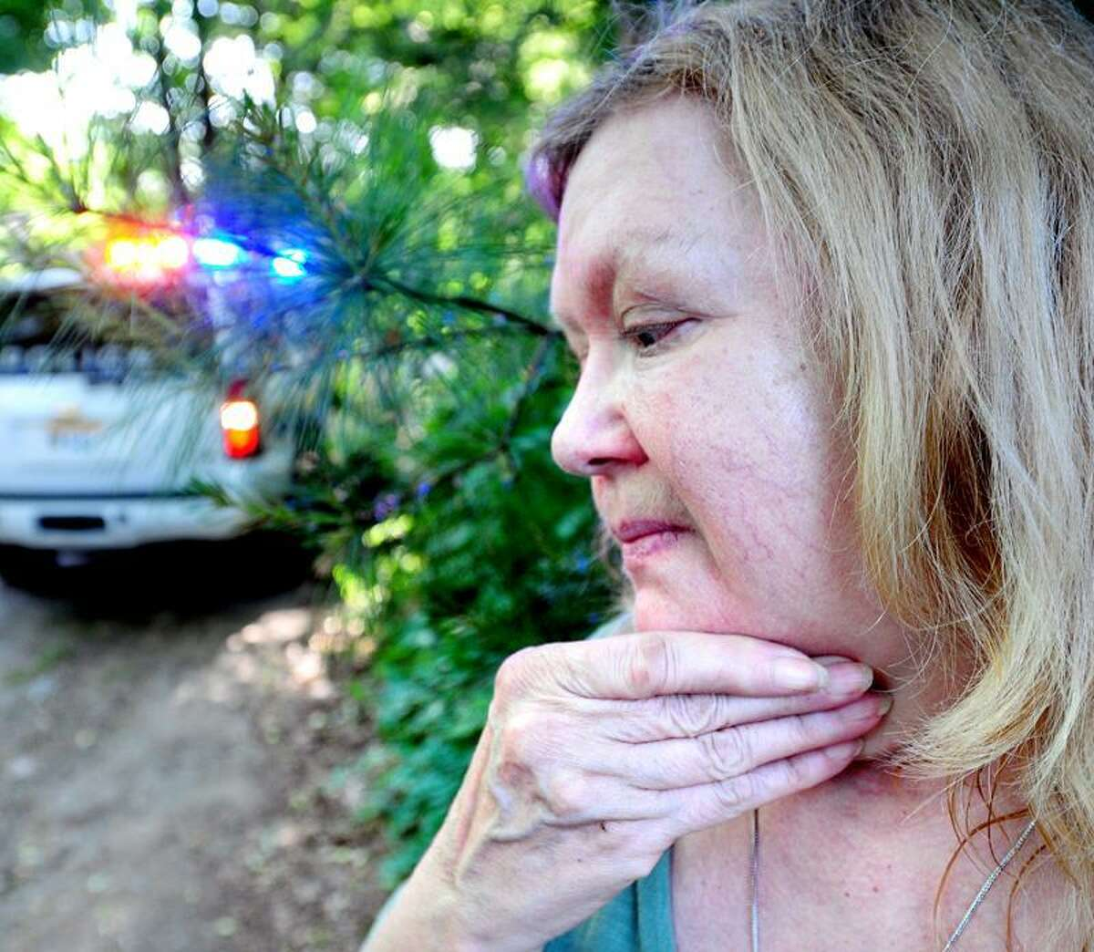 Margaret Syc talks about a collision involving her daughter and granddaughter that took place on a private drive with a train crossing off of Herbert St. in Milford. (Arnold Gold/Register)