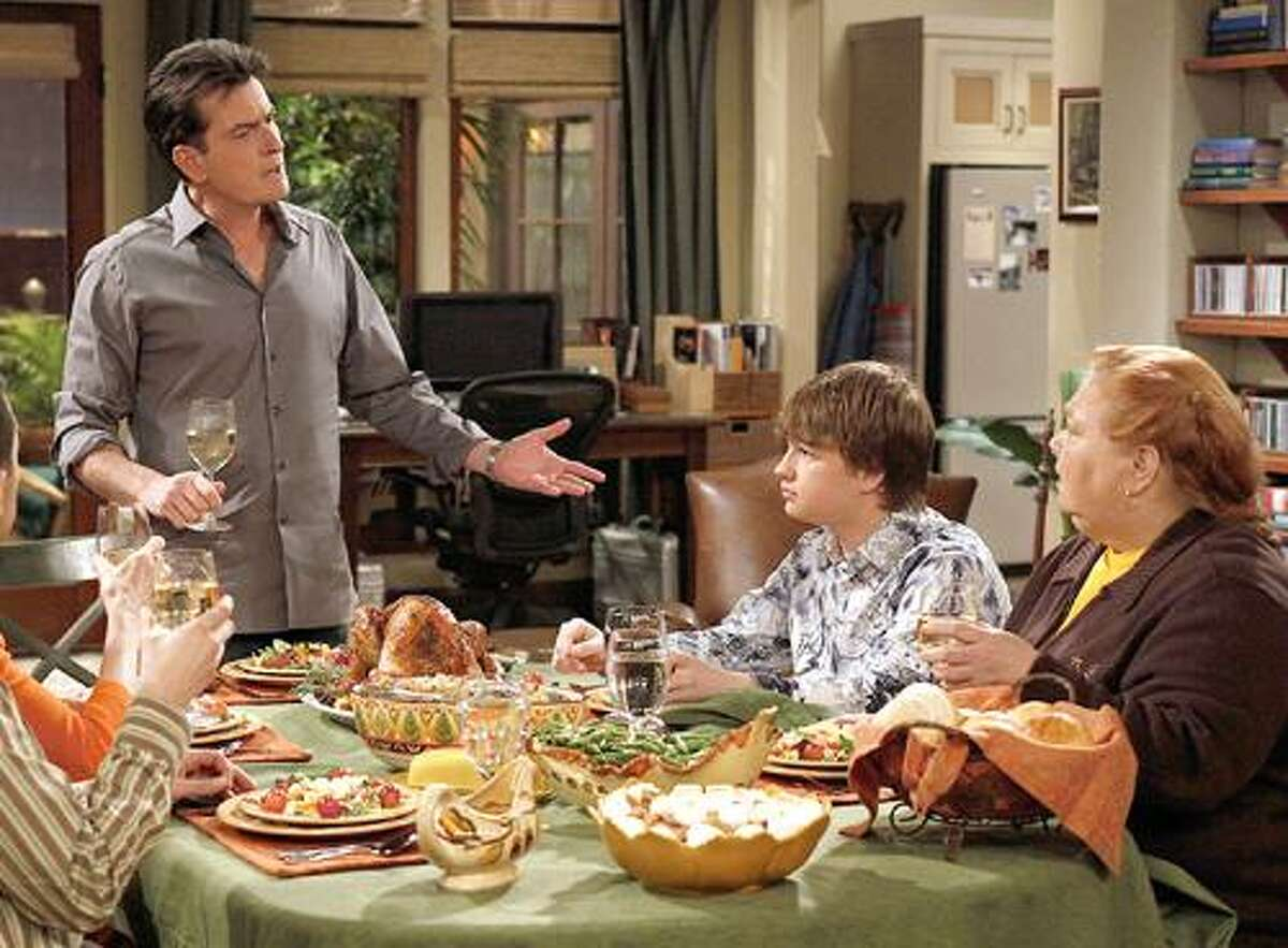 In this undated publicity image released by CBS, from left, Charlie Sheen, Angus T. Jones and Conchata Ferrell are shown during the taping of