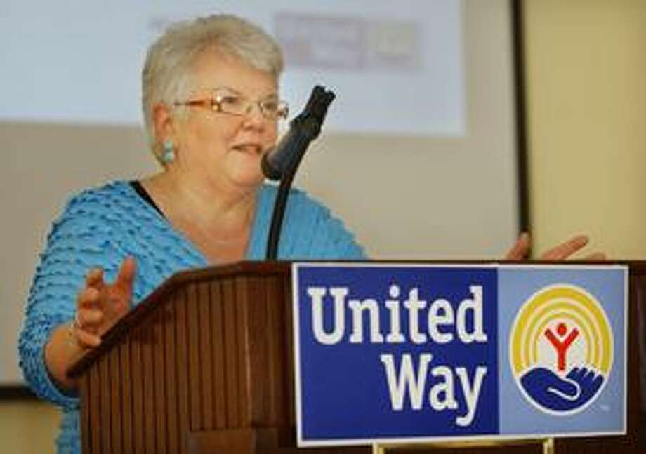 Patti Anne Vassia receives the Community Service Award at the Middlesex United Way breakfast held at the Riverhouse at Goodspeed Junction in Haddam Tuesday. (Catherine Avalone