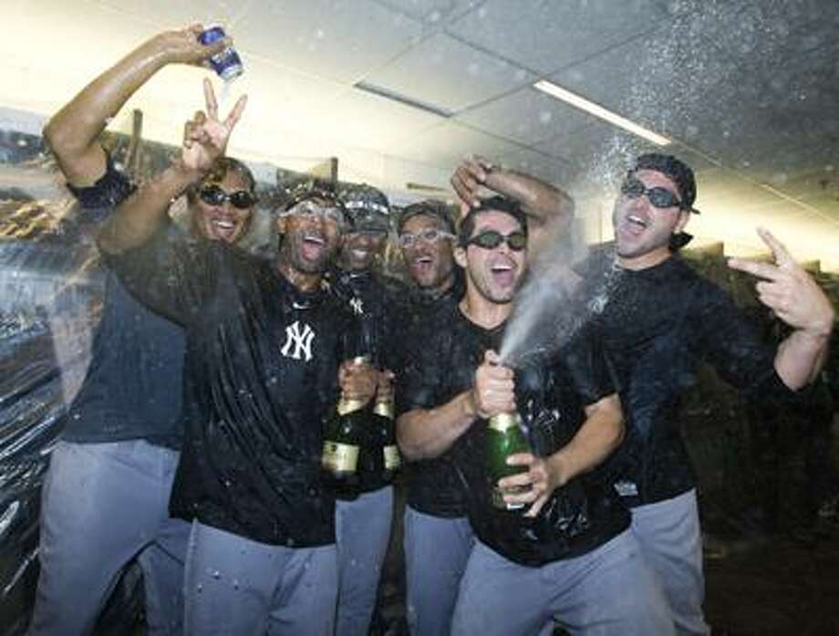 New York Yankees celebrate after clinching a playoff spot with a 6-1 win over the Toronto Blue Jays in a baseball game in Toronto on Tuesday. (AP) Photo: ASSOCIATED PRESS / The Canadian Press