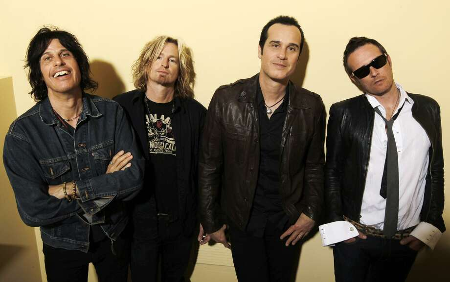 In this April 30, 2010, photo, members of Stone Temple Pilots, from left, Dean Deleo, Eric Kretz, Robert Deleo and Scott Weiland, pose for a portrait in Santa Monica, Calif. (AP) Photo: AP / AP2010