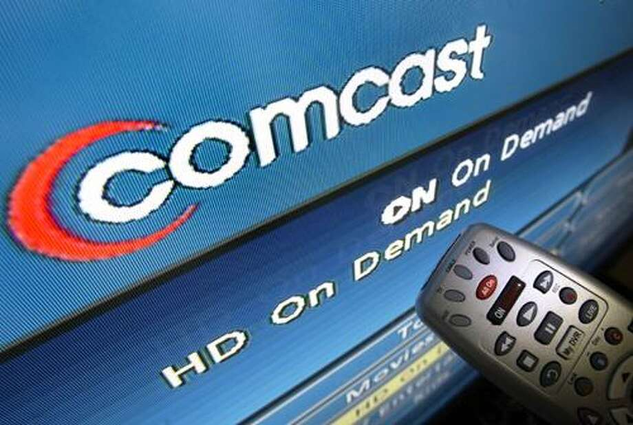 FILE - In this Aug. 6, 2009 file photo, the Comcast logo is displayed on a TV set in North Andover, Mass. The Federal Communications Commission may approve Comcast Corp.'s proposed purchase of NBC Universal Tuesday, Jan. 18, 2011,according to reports. (AP Photo/Elise Amendola, File) Photo: ASSOCIATED PRESS / AP2009