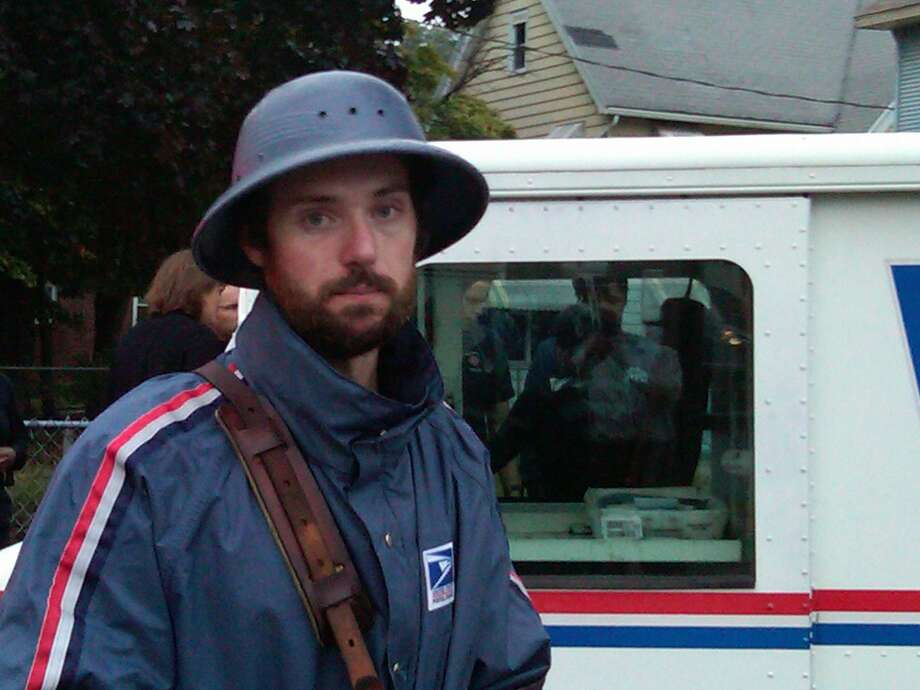 Mail carrier Brian St. John found two children who were in a vehicle that was car jacked Monday and returned them to their mother. Photo by William Kaempffer