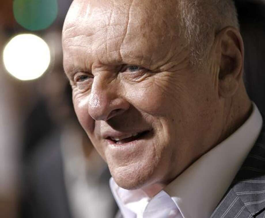 """In this photo taken Jan. 26, 2011, cast member Anthony Hopkins arrives at the premiere of """"The Rite"""" in Los Angeles. Hopkins as Hitchcock? Oscar winner Anthony Hopkins says he hopes play the legendary filmmaker on screen and has been attached to such a project for four years. (AP Photo/Matt Sayles) Photo: AP / AP2011"""