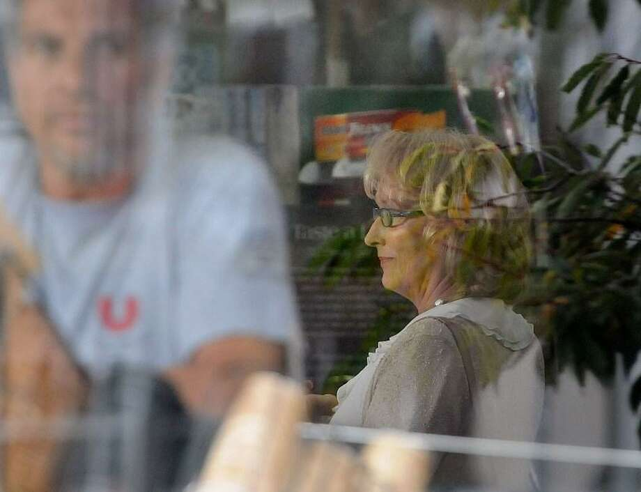 "Meryl Streep can be seen filming the movie ""Great Hope Springs"" inside the Guilford Food Center Tuesday. The movie also stars Tommy Lee Jones and Steve Carell. (Mara Lavitt/Register)"