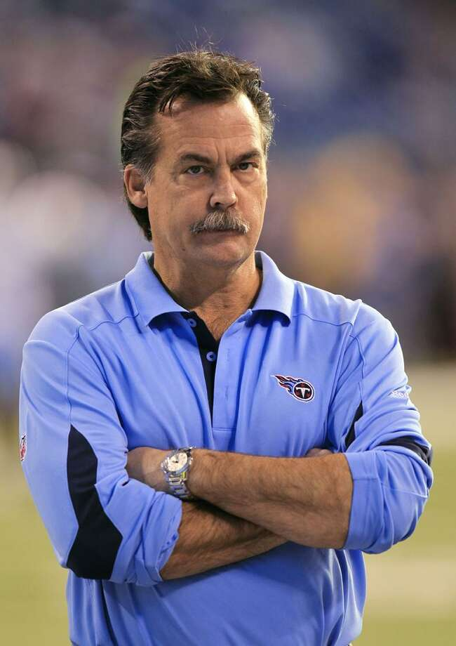 In this Jan. 2, 2011, photo, Tennessee Titans coach Jeff Fisher stands on the field before the Titans' NFL football game against the Indianapolis Colts in Indianapolis. (AP Photo/Michael Conroy) / AP2011