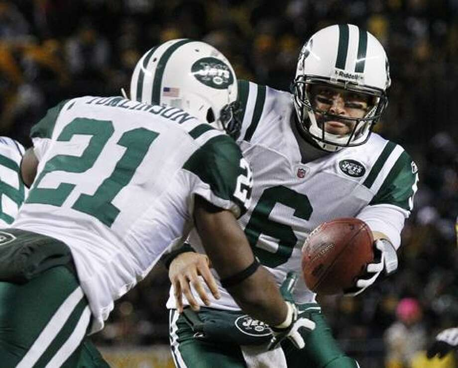 New York Jets quarterback Mark Sanchez (6) hands off to running back LaDainian Tomlinson (21) during the second half of the AFC Championship NFL football game against the Pittsburgh Steelers in Pittsburgh, Sunday, Jan. 23, 2011. (AP Photo/Gene J. Puskar)