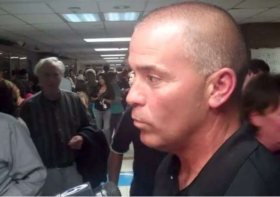 Ousted East Hampton Police Chief Matthew Reimondo attended a Town Council meeting on Tuesday where the council voted to change a town ordinance requiring it to have a police chief. Reimondo is suing to get his job back.