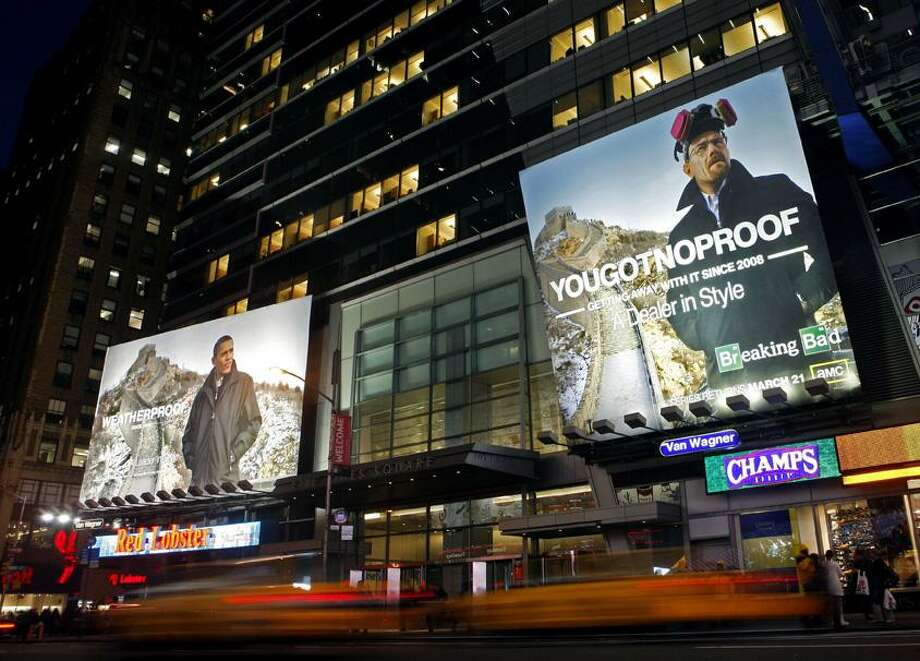 "In this photo provided by AMC, two billboards are shown in Times Square in New York, Friday. The billboard on the left is for the outerwear company Weatherproof and shows President Barack Obama in one of its jackets. The billboard prompted a call of protest from the White House, and now Weatherproof says it's finally removing the offending sign on Wednesday. The AMC network, seeking to grab a piece of the spotlight for one of its TV shows, has mounted its own, even bigger billboard next to the Weatherproof sign, right, replacing the president with the main character of ""Breaking Bad,"" who just happens to be a drug dealer. (AP) Photo: AP / AMC"