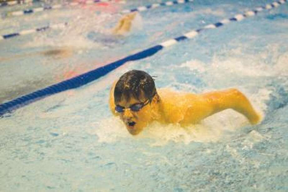 Middletown's Clayton Curran swims the butterfly technique during the 200IM last Friday afternoon at Middletown High School. (Max Steinmetz / Special to the Press)