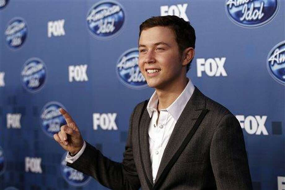 """Scotty McCreery is seen backstage at the """"American Idol"""" finale on Wednesday, May 25, 2011, in Los Angeles. (AP Photo/Matt Sayles) Photo: AP / AP"""