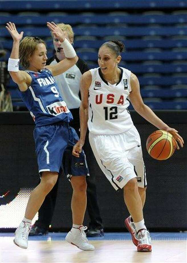 Diana Taurasi, right, of the United States, plays the ball as Celine Dumerc of France, left, tries to stop her during during their World Basketball Championship preliminary round match between US and France in Ostrava, Czech Republic, on Saturday, Sept. 25. (AP Photo/CTK, Jaroslav Ozana) Photo: AP / CTK