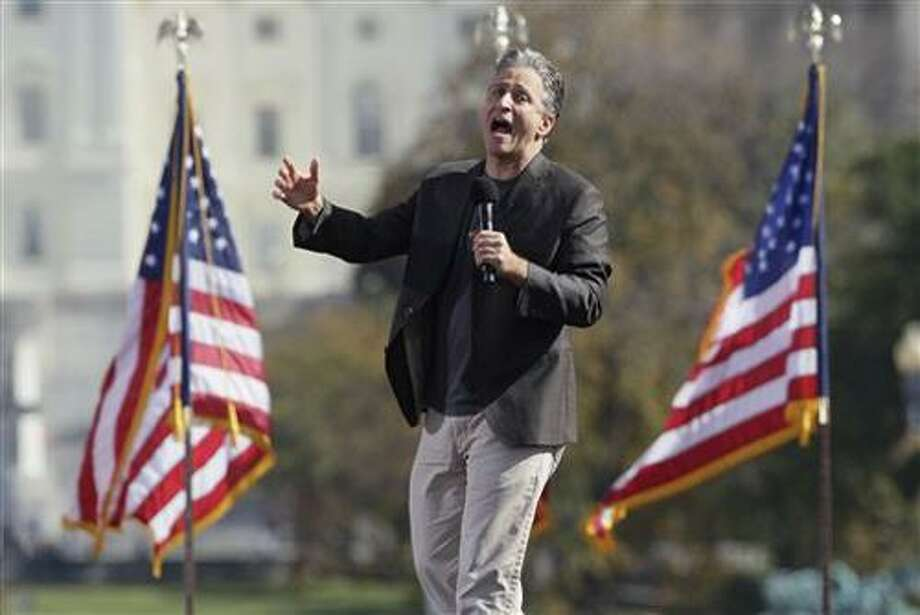 FILE - In a Oct. 30, 2010 file photo, comedian Jon Stewart shouts to the crowd during the Rally to Restore Sanity and/or Fear on the National Mall in Washington. Stewart is to be appointed to the National Sept. 11 Memorial & Museum board at a meeting Thursday, Jan. 27, 2011 in New York.  (AP Photo/Carolyn Kaster, File) Photo: AP / Copyright 2010 The Associated Press. All rights reserved. This material may not be published, broadcast, rewritten or redistribu