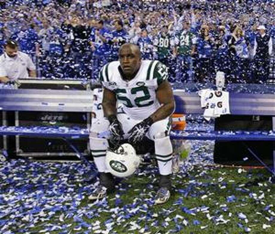 (AP) Jets linebacker David Harris sits among the victors' confetti after the loss. Photo: AP / AP