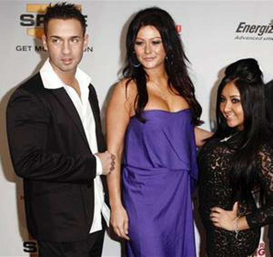 (AP) TV personalities from left, Mike 'The Situation' Sorrentino, Jenni 'J-Woww' Farley and Nicole 'Snooki' Polizzi arrive at Spike TV's Video Game Awards in Los Angeles Dec. 12, 2009. Photo: ASSOCIATED PRESS / AP2009