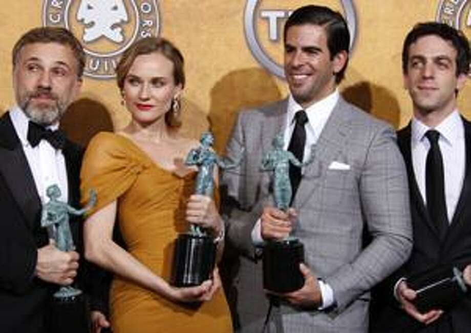"""From left, actors Christoph Waltz, left, Diane Kruger, Eli Roth, and B.J. Novak, cast members from """"Inglourious Basterds"""", pose together backstage after the film won best cast ensemble at the 16th Annual Screen Actors Guild Awards on Saturday, Jan. 23, 2010, in Los Angeles.  (AP Photo/Reed Saxon) Photo: ASSOCIATED PRESS / AP2010"""