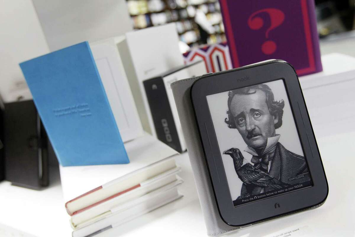 """The new Nook and some accessories are displayed during a news conference Tuesday, in New York. The new Nook features a black-and-white touch screen and aims squarely at the """"grandma"""" demographic. (AP Photo/Mary Altaffer)"""