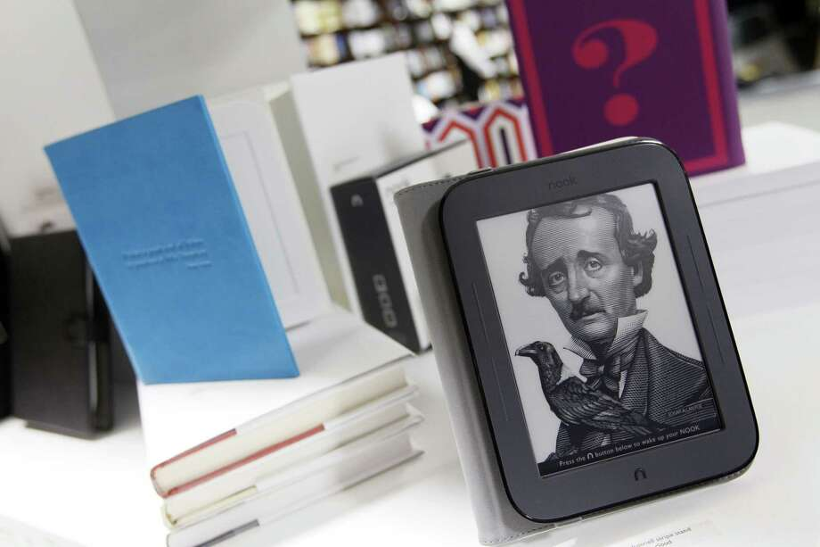"""The new Nook and some accessories are displayed during a news conference Tuesday, in New York. The new Nook features a black-and-white touch screen and aims squarely at the """"grandma"""" demographic. (AP Photo/Mary Altaffer) Photo: ASSOCIATED PRESS / AP2011"""