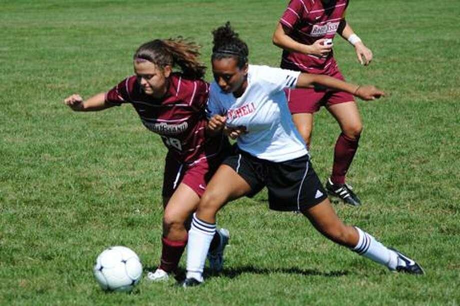 Maariyah Lombardo, right. Photo courtesy of Mitchell College Athletics.