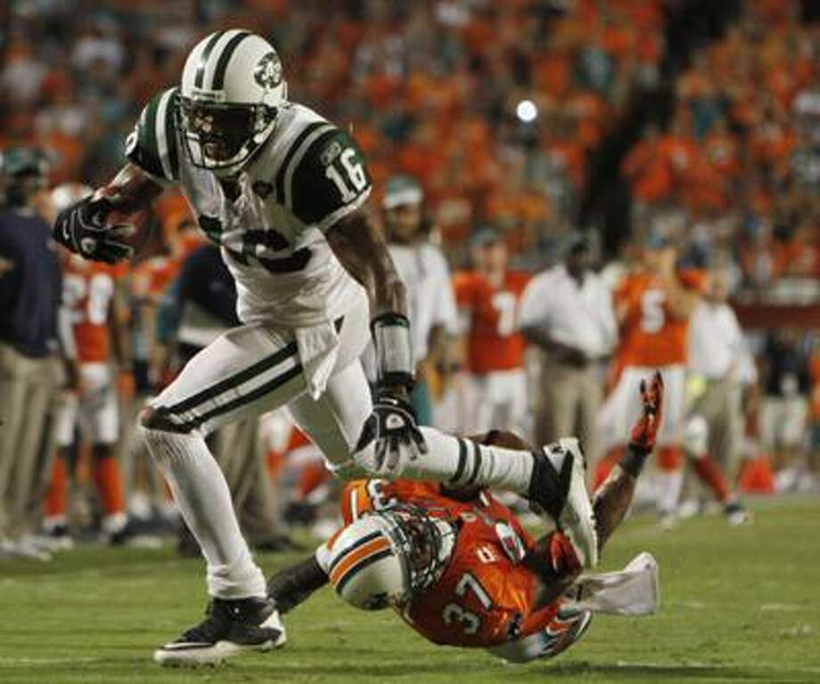 New York Jets wide receiver Brad Smith (16) runs for yardage as Miami Dolphins safety Yeremiah Bell attempts the tackle during the second half of an NFL football game, Sunday. (AP) Photo: ASSOCIATED PRESS / AP