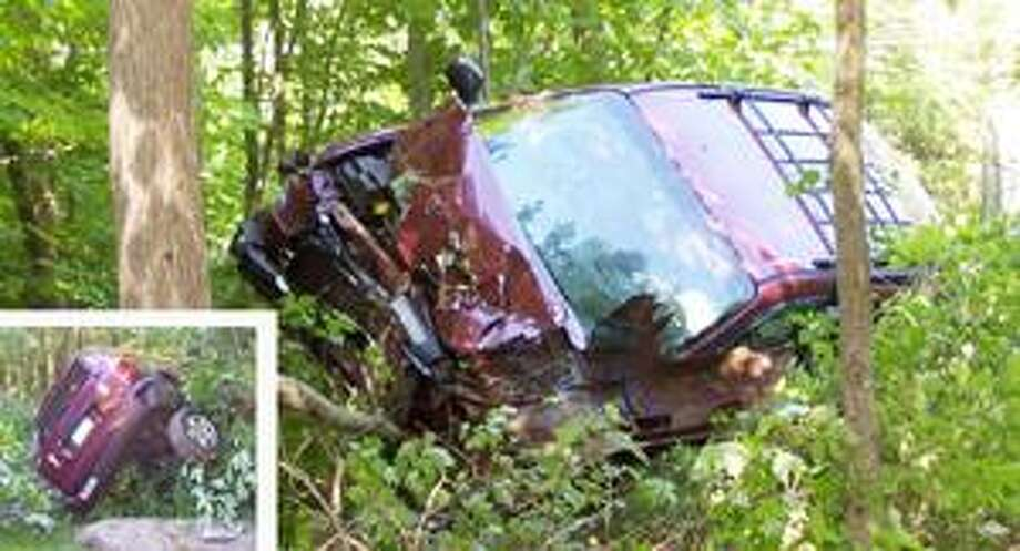 (Submitted photo) Christopher Gagne, 19, drove off the road at a high rate of speed in a heavily-wooded area off rural Stephen Tom Road in Portland Tuesday. He wound up with his vehicle heavily damaged and pitched up on just two wheels.