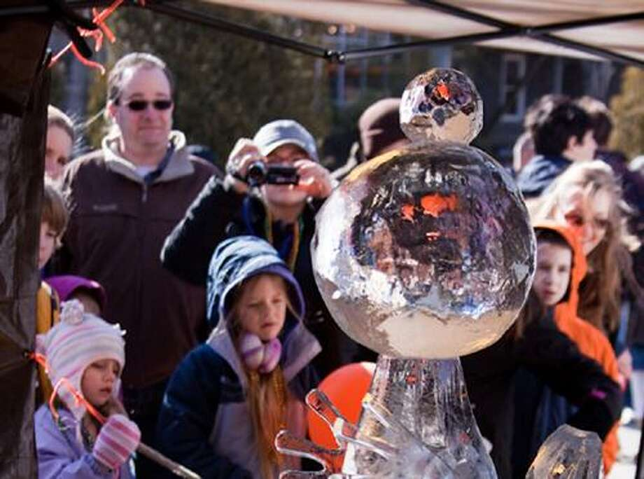 """The Ice Carving Competition, at the Annual Winter Carnivale, features professional and semi-professional carvers. Spectators may vote for their favorite sculpture to win the """"People's Choice Award."""""""