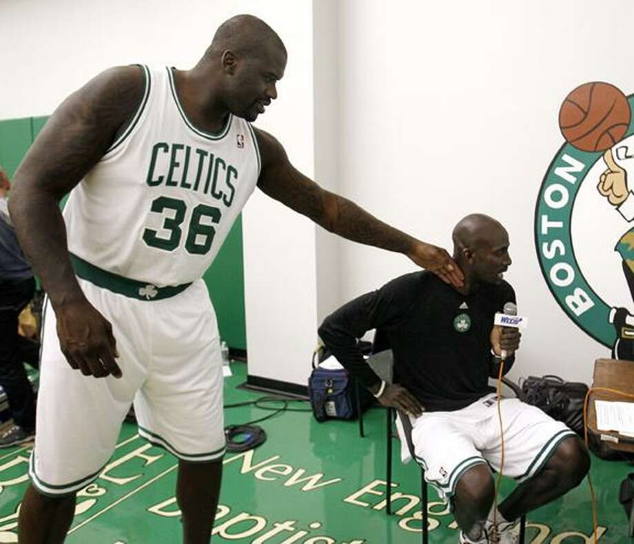 "Boston Celtics' Shaquille O'Neal teases teammate Kevin Garnett as he does a radio interview during media day at the team's NBA basketball training camp in Waltham, Mass., Monday. Check out some video of the day at <a href=""http://middletownpress.com"">middletownpress.com</a>. (AP Photo/Winslow Townson) Photo: AP / FR170221 AP"
