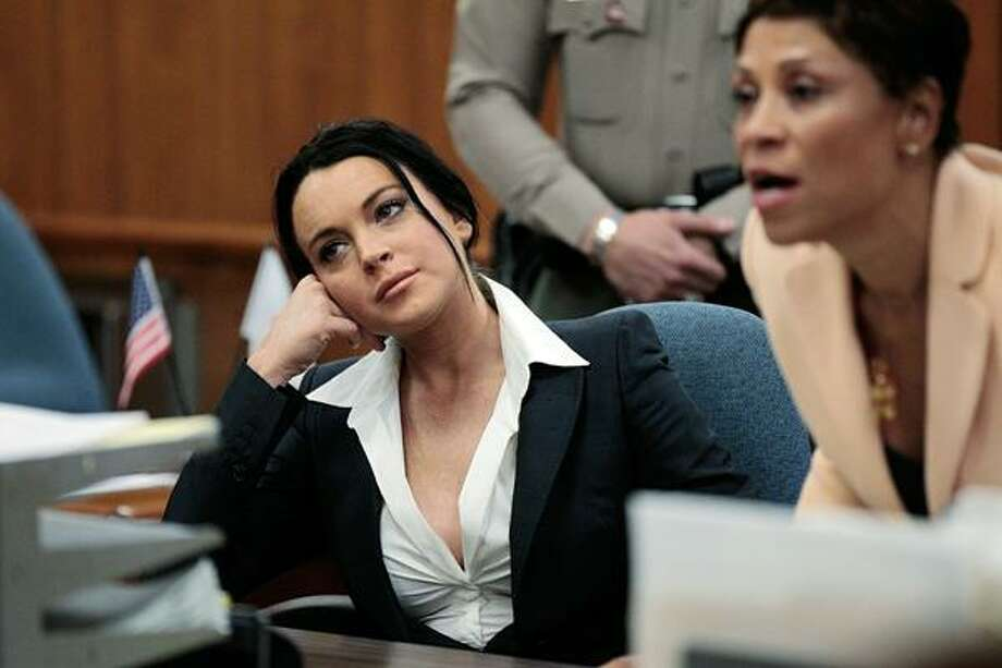Actress Lindsay Lohan, left, is shown in court with her attorney Shawn Chapman Holley during a hearing in Beverly Hills, Calif., Monday. (AP) Photo: ASSOCIATED PRESS / AP2010