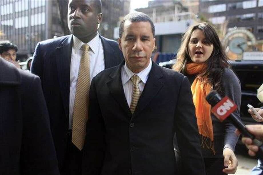 New York Gov. David Paterson, center, arrives at his midtown office,  in this March 5 file photo taken in New York.  (AP Photo/Mary Altaffer) Photo: AP / AP2010
