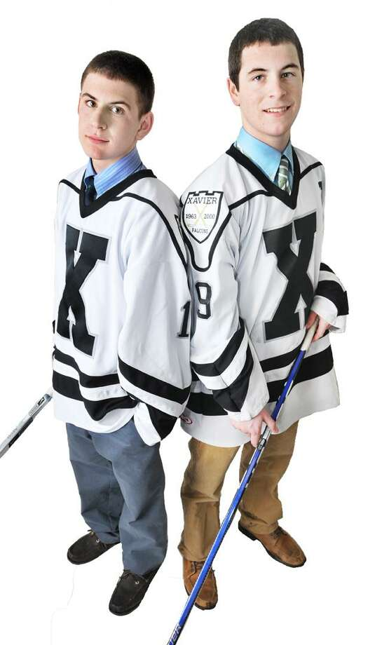 """The Middletown Press  1.25.11  Xavier senior captain, Charlie DuPont, at right and his younger brother, Dan, a Xavier sophomore are members of the Xavier hockey team. To buy a glossy print of this photo and more, visit <a href=""""http://www.middletownpress.com"""">www.middletownpress.com</a> / TheMiddletownPress"""