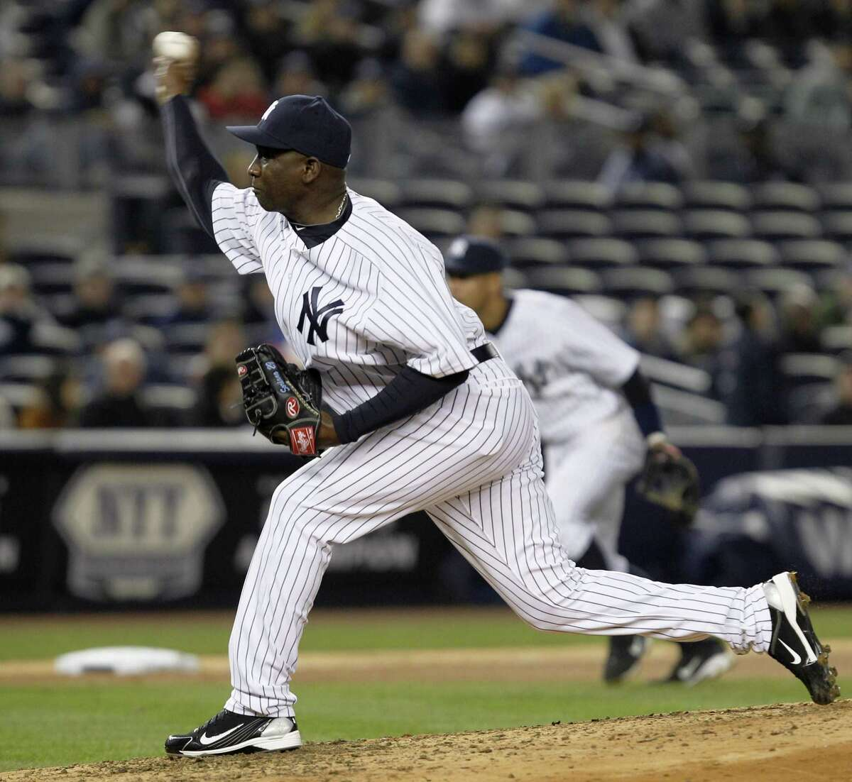 New York Yankees relief pitcher Rafael Soriano delivers in the eighth inning of the Yankees' 4-3 victory over the Minnesota Twins in a baseball game at Yankee Stadium in New York, Monday, April 4, 2011. (AP Photo/Kathy Willens)