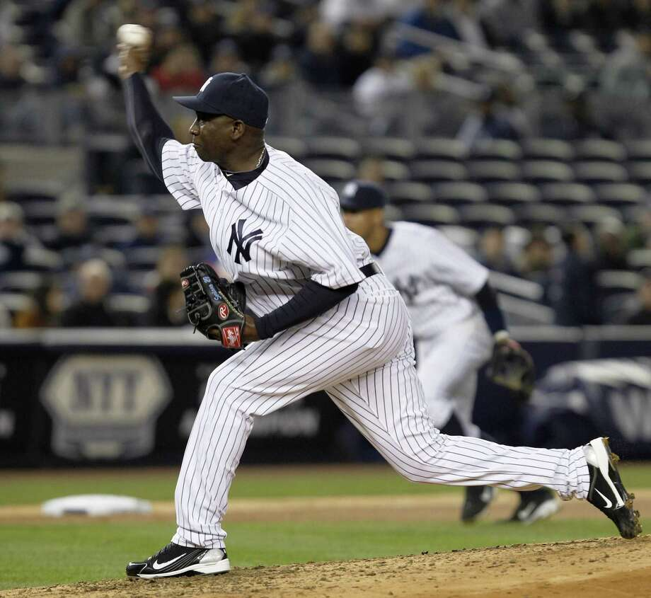 New York Yankees relief pitcher Rafael Soriano delivers in the eighth inning of the Yankees' 4-3 victory over the Minnesota Twins in a baseball game at Yankee Stadium in New York, Monday, April 4, 2011. (AP Photo/Kathy Willens) Photo: ASSOCIATED PRESS / AP2011