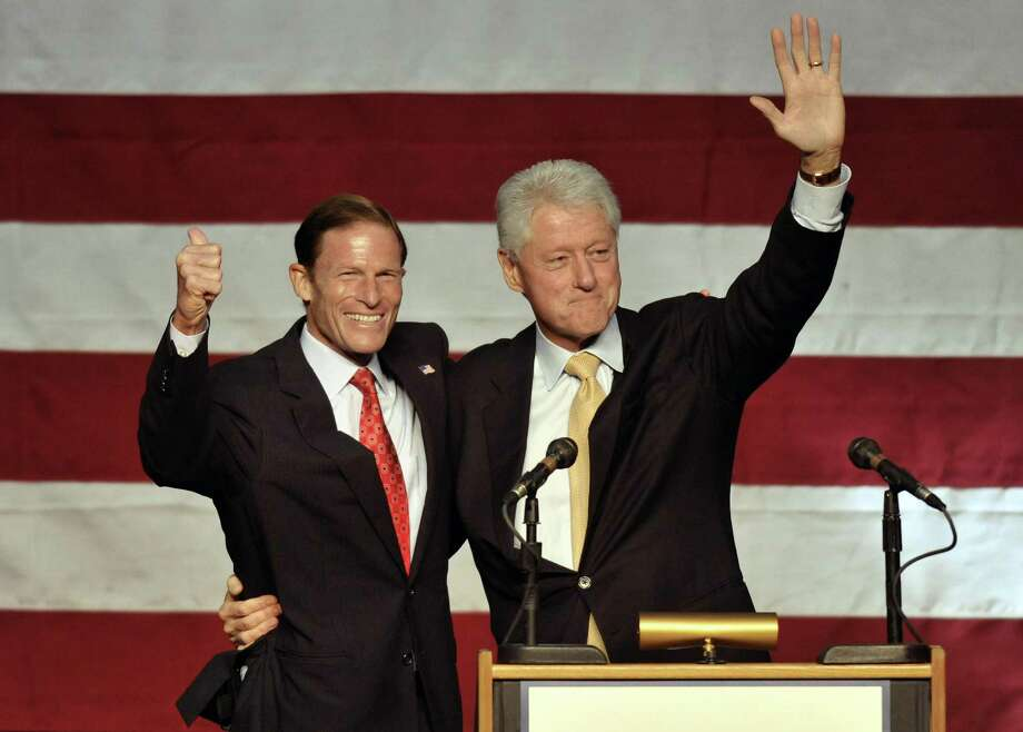 Former President Bill Clinton, right, campaigns for Democratic U.S. Senate candidate Richard Blumenthal, left, in New Haven, Conn., on Sunday, Sept. 26, 2010.  (AP Photo/Jessica Hill) Photo: ASSOCIATED PRESS / FR125654 AP