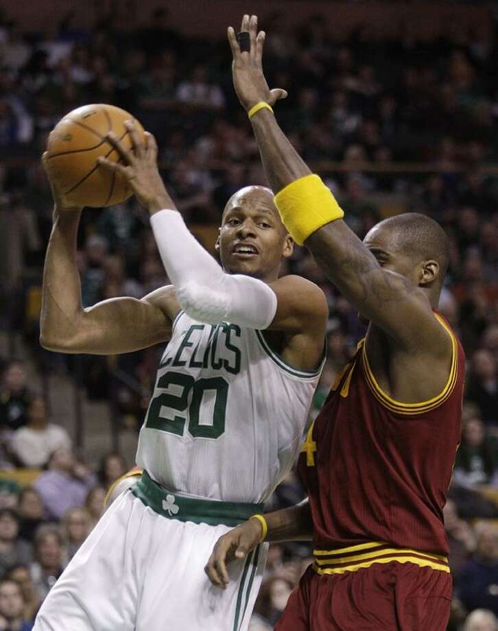 Boston Celtics guard Ray Allen (20) goes up for a shot as Cleveland Cavaliers forward Antawn Jamison (4) defends during the second quarter of an NBA basketball game Tuesday, Jan. 25, 2011, in Boston. (AP Photo/Stephan Savoia)