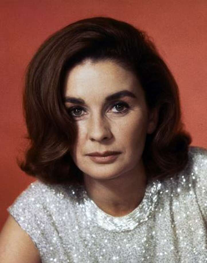"""In this 1965 file photo, Actress Jean Simmons, wearing sleeveless dress. Simmons, the stunning beauty who sang with Marlon Brando in """"Guys and Dolls"""" and played Ophelia to Laurence Olivier's Hamlet, has died.  Simmons, the stunning beauty who sang with Marlon Brando in """"Guys and Dolls"""" and played Ophelia to Laurence Olivier's Hamlet died Friday, Jan. 22, 2010. She was 80. (AP Photo, File) Photo: ASSOCIATED PRESS / AP1965"""