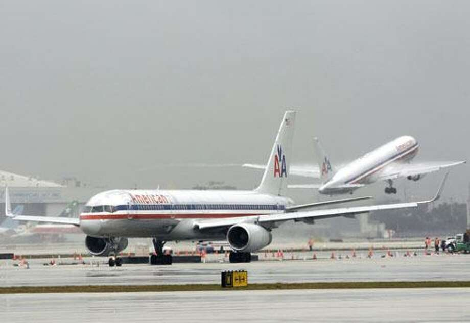 FILE - In this Feb. 1, 2010 file photo, American Airlines jets are seen at the Miami International Airport in Miami. The parent of American Airlines loses $97 million in the fourth quarter Wednesday, Jan. 19, 2011, as the nation's third-biggest airline recovers from the recession more slowly than its rivals.(AP Photo/Mark Humphrey, file) Photo: ASSOCIATED PRESS / AP2010
