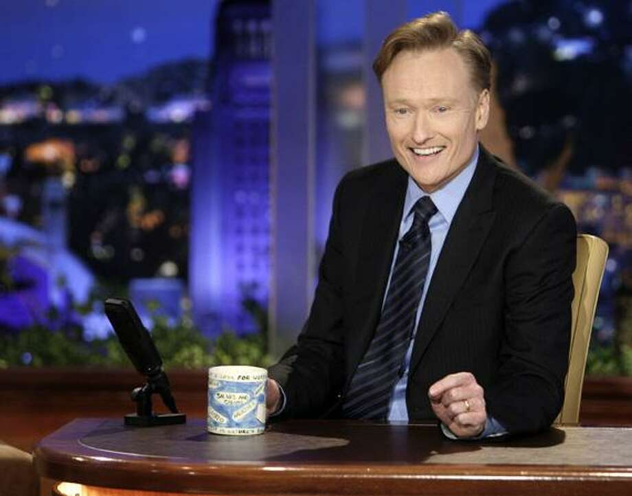 """In this June 1, 2009 file photo provided by NBC, Conan O'Brien makes his debut as the host of NBC's """"The Tonight Show"""" in Universal City, Calif. (AP)"""