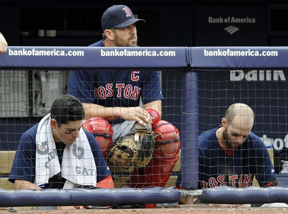 Boston Red Sox's Jacoby Ellsbury, left, Jason Varitek and Dustin Pedroia, right, react during the eighth inning of the first game of a baseball doubleheader against the New York Yankees, Sunday, Sept. 25, 2011, at Yankee Stadium in New York. The Yankees defeated the Red Sox 6-2. (AP Photo/Bill Kostroun) Photo: ASSOCIATED PRESS / AP2011