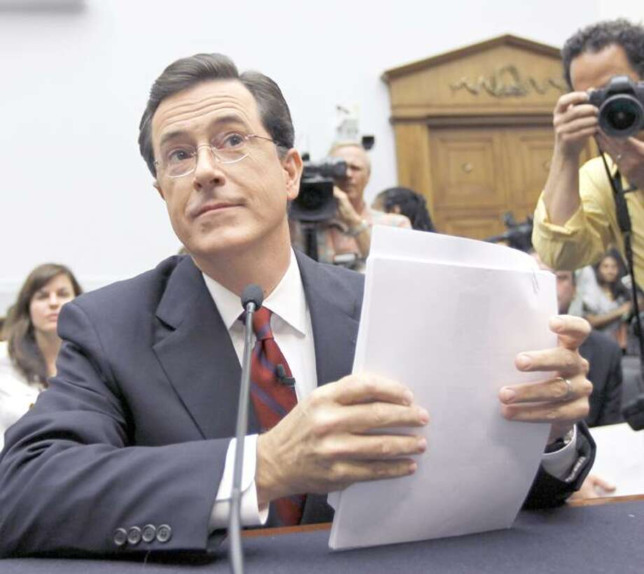 Comedian Stephen Colbert, host of the Colbert Report, prepares to testify on Capitol Hill in Washington, Friday, Sept. 24, 2010, before the House Immigration, Citizenship, Refugees, Border Security and International Law subcommittee hearing on Protecting America's Harvest. (AP Photo/Alex Brandon) Photo: ASSOCIATED PRESS / AP